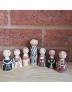Hand painted peg doll figures from history.